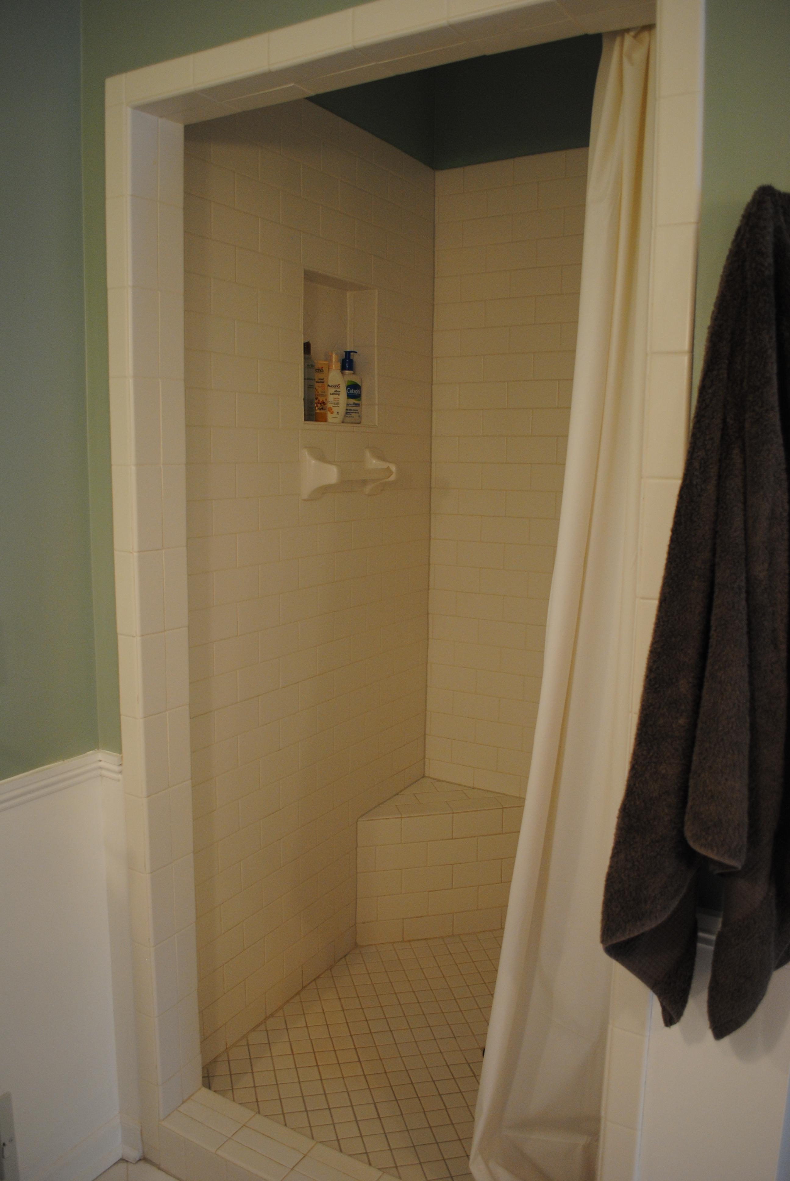 For me remember that ugly torn wheel well from the before pictures - Since We Have Well Water And It Is Hard To Keep The Grout In The Shower Pure White I Am Thinking We Should Actually Re Grout The Shower In A Gray